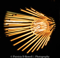 Light  Fantastic 2 (Patricia Rowell) Tags: light bulbs bridge sun set lamp shades