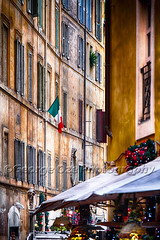 Narrow Street in  Rome During The Christmas Holiday (George Oze) Tags: alley architecture buildingexteriors canopy christmas colorful daytime europe europeanunion faded flag historic holidaydecorations houseexterior italy lazio lifestyle multistory narrowstreet nopeople nobody old outdoors quaint rome scenic shutters street streetphotography travel tricolorflags vertical windows it
