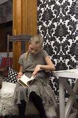 Girl reading (jannaheli) Tags: suomi finland lappeenranta ristiäiset christening namingceremony nikond7200 tyttö girl lukemassa reading keinu swing