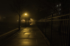 A foggy night in downtown Bay City (TAC.Photography) Tags: walking ironfence nighttime baycity glowinglight streetscene streetlights leadinglines sidewalk nightlights nightphotography streetphotography tacphotography