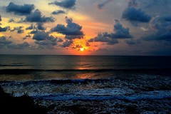 Bali, Indonesia (sharathponnappa) Tags: bali indonesia beach waves sunset surfers nikon d3200 clouds indianocean tanahlot nature