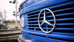 Benz in blue (Eric Flexyourhead) Tags: vancouver canada britishcolumbia bc strathcona city urban detail fragment truck german mercedes mercedesbenz grille badge emblem logo shallowdepthoffield 169 sonyalphaa7 zeisssonnartfe35mmf28za zeiss 35mmf28