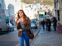 Red Head (Howie Mudge LRPS) Tags: girl woman female people men women candid casual portrait redhair strawberryblonde bokeh bokehlicious bokehful outside outdoors aberystwyth ceredigion wales cymru uk travel travelling traveler color colour street streetphotography streetlife pavement road signs cars van vehicles panasonic lumix microfourthirds micro43 micro43mountlenses m43 mft panasonicdmcg80 lumixg425f17