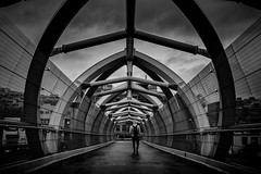 Puente De Luz (Dan Fleury Photos) Tags: cans2s canada toronto ontario yyz the6ix street brige dark light bnw black white pedestrian stormy skies sky walking walk