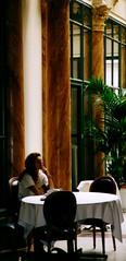 Withdrawn (:Linda: (OFF. - Craftsmen!)) Tags: people plant paris france window hair table clothing chair sitting loneliness leute hand adult drink fenster think dream hairdo frisur clothes 1993 eat sit leisure lonely column tablecloth einsamkeit pleasure einsam haare mensch kleidung getrnk haar lonesome sitzen sule allein bekleidung galeriescolbert sitzgelegenheit alleinsein erwachsener