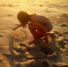 Writing in the sand (neloqua) Tags: ocean light sea summer brazil sun sunlight beach southamerica girl beautiful riodejaneiro wonderful wonder fun daylight amazing fantastic sand perfect great adorable sunny excellent summertime moment lovely charming sunsetlight niteroi sunnyday