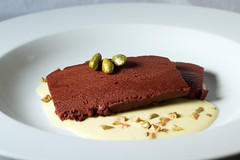 Chocolate terrine with Custard Sauce and Pistachios (ilmungo) Tags: food cooking kitchen dessert chocolate terrine custard creme anglaise cremeanglaise pistachio golden powder topv111