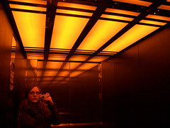 CIMG5123 (emma b) Tags: 2005 march cardiff emma parkplaza hotel elevator orange light lights selftake mirror reflection wales bathed portfolio