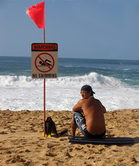 say no to crack (hokulea) Tags: waimea waimeabay oahu northshore beach hawaii december 2005 sand boogieboard fins shades waves warning danger crack okole asscrack saynotocrack crackiswhack cheeky interestingness topv111 topv222 topv333 topv444