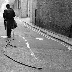 tentacle man (pixietart) Tags: blackandwhite favorite london square weird tubes trenchcoat eccentric bricklane hoses bestphotoever revol