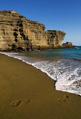 Disappearing Act (j o s h) Tags: ocean beach ilovenature hawaii sand footprints cliffs bigisland greensandbeach mahanabay