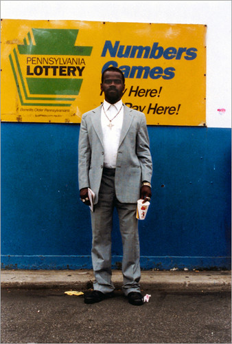 36-man in front of lottery sign.jpg