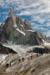 Glacier hike under Cerro Torre (Flickmor) Tags: people patagonia mountain mountains topf25 argentina landscape geotagged day 500v20f cloudy 100v10f cliffs moo glaciers jagged hikers peaks glacierhiking losglaciares cerrotorre elevation30003500m losglaciaresnationalpark mountainsandes 1000v40f specland geo:lat=49323662 geo:lon=7