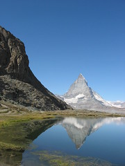 Matterhorn Reflection (zdaddyo) Tags: blue sky mountain lake snow reflection nature topf25 landscape switzerland topv999 100v10f matterhorn riffelsee mountainsalps 1111v11f elevation40004500m altitude4478m summitmatterhorn cotcmostfavorited 999v9f interestingness42 mywinners