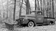 An old truck with a snow plow.