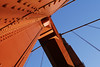 golden ray (helveticaneue) Tags: sanfrancisco bridge blue red vacation sky june angles 2006 goldengatebridge cables bolts alamy kicey laurakicey walkwithjohncurley alamylead