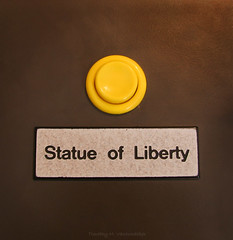 The Yellow Button (T1MV4N) Tags: new york ny yellow statue lady liberty do eiffel it dont shore questionmark button push statueofliberty press ladyliberty pressit