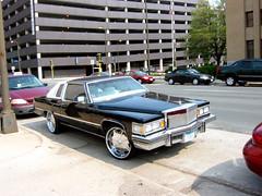 77CADI (bmw328driver) Tags: usa silly car minnesota canon downtown minneapolis cadillac mn s30 pimpmobile hugewheels