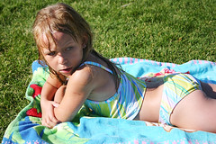 Time to get a suntan (paigelynn) Tags: girl kids canon children outside outdoors kid interestingness child daughter 2006 carrie spraypark interestingness164 i500 paigelynn thebiggestgroup explore02jul06 paigemandera