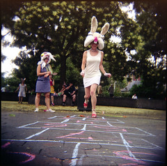 Carrot Hopscotch in Washington Square Park (pixietart) Tags: nyc blur tree rabbit bunny film nycpb square costume holga washingtonsquarepark ears suzanne plastic gothamist carrots lacey hopscotch skip vignette madagascarinstitute duelingreenactments siohban