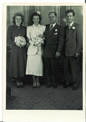 My great Aunt Phyllis chose a white suit and a gardenia in her hair, although this look might work with a hat too.