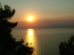 sunset over Thassos island (grk1) Tags: sea summer vacation sun bird nature ship wind wave 2006 greece odmor nikola ellas thassos grcka reljin nikkonstunninggallery limenas
