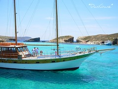 Comino  Laguna Blu (*DaniGanz*) Tags: blue sea sky beach water rock island boat interestingness europe barca mare blu turquoise malta explore cielo roccia acqua azzurro spiaggia bluelagoon mediterraneansea azur isola turchese comino marmediterraneo daniganz lagunablu flickrsexplore