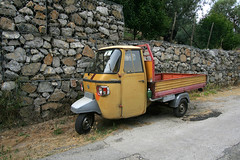 Piaggio patchwork (dr_loplop) Tags: italy orange green water wheel yellow three bottle rocks campania ape van piaggio gabions p601 freethegabions