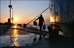 Fisherman (Mediterraneo) Tags: street sea people colour topf25 kodak croatia rangefinder zadar yashica 45mm adriatic dalmatia yashinondx top20travel