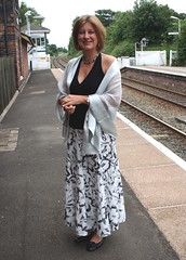 Dressed up (copperbottom1uk) Tags: woman smile cheshire trainstation mobberleystation