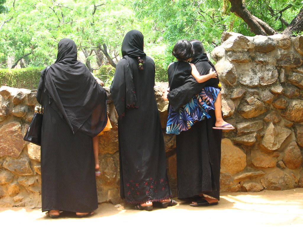 Muslim Women watching Crocs