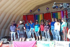 "Spectrum Choir on stage at Plymouth Pride 2015-1 • <a style=""font-size:0.8em;"" href=""http://www.flickr.com/photos/66700933@N06/20443778109/"" target=""_blank"">View on Flickr</a>"