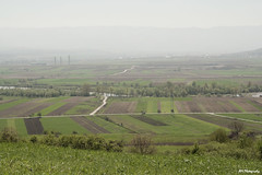 Countryside (Puiu Adriana Mirabela) Tags: road travel summer panorama tourism field grass rural season countryside europe afternoon village view cloudy outdoor background country hill farming seasonal grow lot property peaceful romania vegetation agriculture limit tranquil cultivate