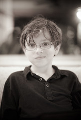 plucky (JoeBenjamin) Tags: boy portrait bw white black blanco smile face smiling youth hair 50mm prime glasses kid child y sony voigtlander young fast messy grin grinning specs spectacles f11 nokton ilce tussled niero a7r ba247a