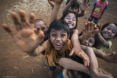 kids will be kids (jrockar) Tags: life trip travel girls people 3 boys kids canon children photography hands seasia village play shot mark iii streetphotography documentary snap dirt busy messy instant l 5d curious moment dust laos excitement 1740 mk decisive oncearoundthesun banebeng
