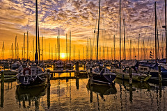 Counting Masts (Alfred Grupstra Photography) Tags: light sky water clouds reflections landscape boats nikon sundown harbour nederland nl noordholland andijk
