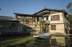 A boat in the driveway (Shubh M Singh) Tags: people india lake architecture boat dal gr kashmir srinagar ricoh jammu srinagr