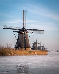 Ice skating at Kinderdijk (Martijn Bergsma) Tags: ice skating kinderdijk rotterdam sky winter water cold blue white snow holland netherlands mill windmill schaatsen