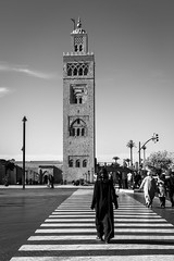 Call to Prayer (Sandy Sharples) Tags: koutoubia mosque marrakesh morocco prayer crossing woman monochrome mono city travel contrast africa