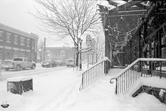 Film Photography: Up the Stairs to Mangia, Orchard Park, NY (NFE_0062) (masinka) Tags: orchardpark ny newyork mangia ristorante restaurant film analog blackandwhite bw nikon fe ilford delta 100 winter season white snow storm winterstorm snowfall snowstorm wny 716 etbtsy