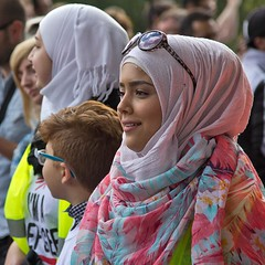 Don't Bomb Syria, London, 12 September 2015 (chrisjohnbeckett) Tags: street red portrait people urban london smile square march war peace refugees politics headscarf protest photojournalism documentary demonstration syria bomb timeout global reportage londonist canonef24105mmf4lisusm