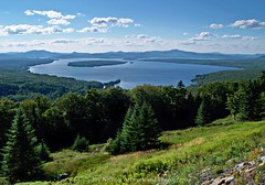 Height Of The Land Overlooking Mooselookmeguntic Lake (joyolsonnichols) Tags: travel blue trees summer sky panorama usa lake mountains green nature water beautiful clouds landscape outdoors photography woods view joy maine scenic newengland peaceful vista northamerica lovely overlook tranquil rangeley nichols olson mooselookmeguntic scenicbyway route17 franklincounty westernmaine rangeleylakes heightoftheland joynichols toothakerisland joynicholsartworkandphotography heightofthelandoverlookingmooselookmegunticlake