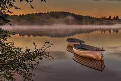 Loch Rusky Calm, Scotland (ajnabeee) Tags: morning trees light orange mist lake reflection tourism clouds forest sunrise boats dawn scotland boat still warm glow stirling calm foliage loch trossachs aberfoyle rusky lochrusky