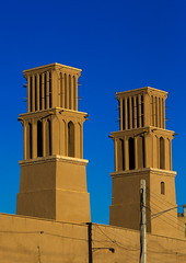 wind towers used as a natural cooling system in iranian traditional architecture, Yazd Province, Yazd, Iran (Eric Lafforgue) Tags: city travel urban building tower tourism vertical architecture outdoors persian day view desert iran traditional towers middleeast culture persia bluesky nobody nopeople architectural tradition catcher orient cultural clearsky windcatcher yazd windtower badgir persiangulfstates coolingsystem  buildingexterior  16022 colourimage  iro  yazdprovince builtstructure westernasia