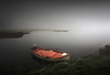 Boat in the mist (ilias varelas) Tags: greece ilias varelas nature atmosphere dark light mist fog mood winter water boat land