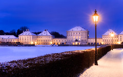 Snow Fortress (One_Penny) Tags: bayern deutschland germany münchen nympenburg schlossnymphenburg architecture bavaria building canon6d castle lamp light munich photography schloss fortress morning early snow white blue glow dreamy sky winter cold digitalblending exposureblending
