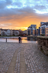 Taking in the view (MilesGrayPhotography (AnimalsBeforeHumans)) Tags: architecture auldreekie britain canon 6d canon6d 1635 ef1635mmf4lisusm city dusk edinburgh eos ef europe evening f4l glow historic iconic lens leith nd nighfall outdoors photography reflections scotland skyline sky sunset shore town twilight uk usm unitedkingdom water winter waterofleith