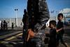 * (Sakulchai Sikitikul) Tags: street snap streetphotography songkhla voigtlander 28mm thailand children military soldier balloon sony a7s machinegun childrensday