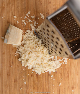 Grating Parmigiano-Reggiano.
