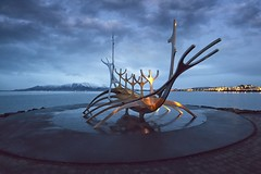Sun Voyager at Daybreak (Alan Amati) Tags: amati alanamati iceland icelandic reykjavik daybreak earlymorning early earlylight sun voyage voyager sunvoyager shore winter public art sculpture rays mountains water viking ship iconic